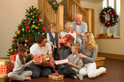 happy-family-and-grandparents-handing-out-presents-on-christmas-day_ahcsvl